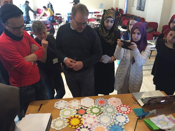 Eric Broug showing students all of their designs together